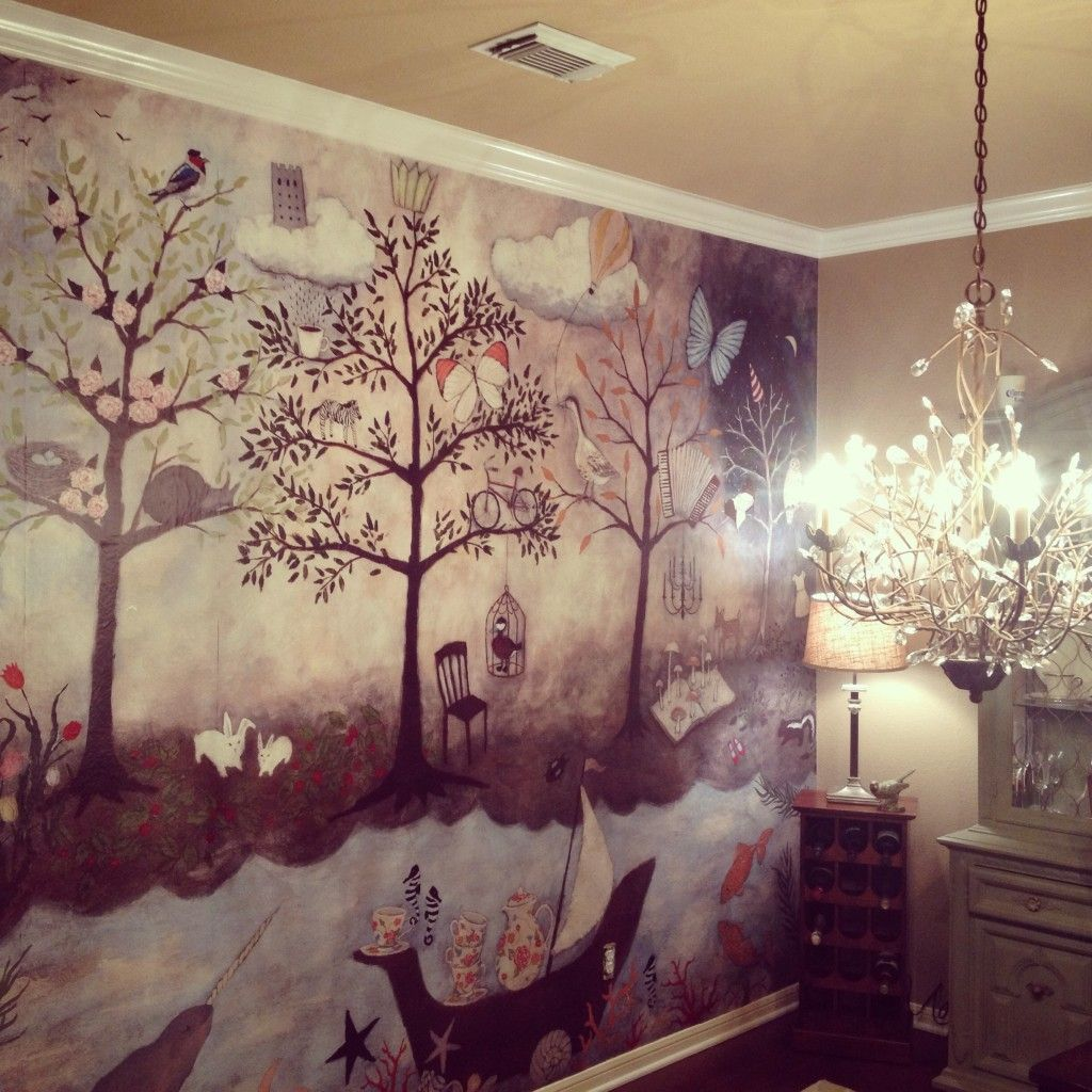 anthro enchanted forest mural by rebecca rebouche already hanging on the wall