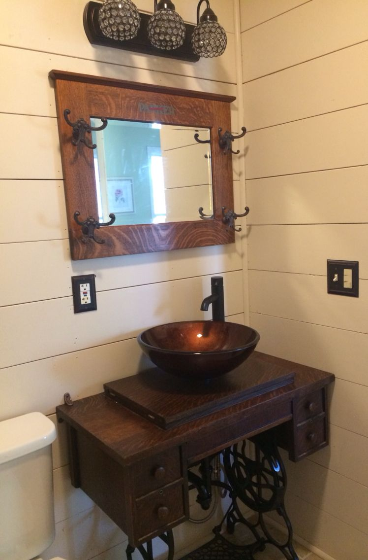 Treadle sewing machine cabinet made into a sink base. Treadle sewing machine cabinet made into a sink base    Ideoita