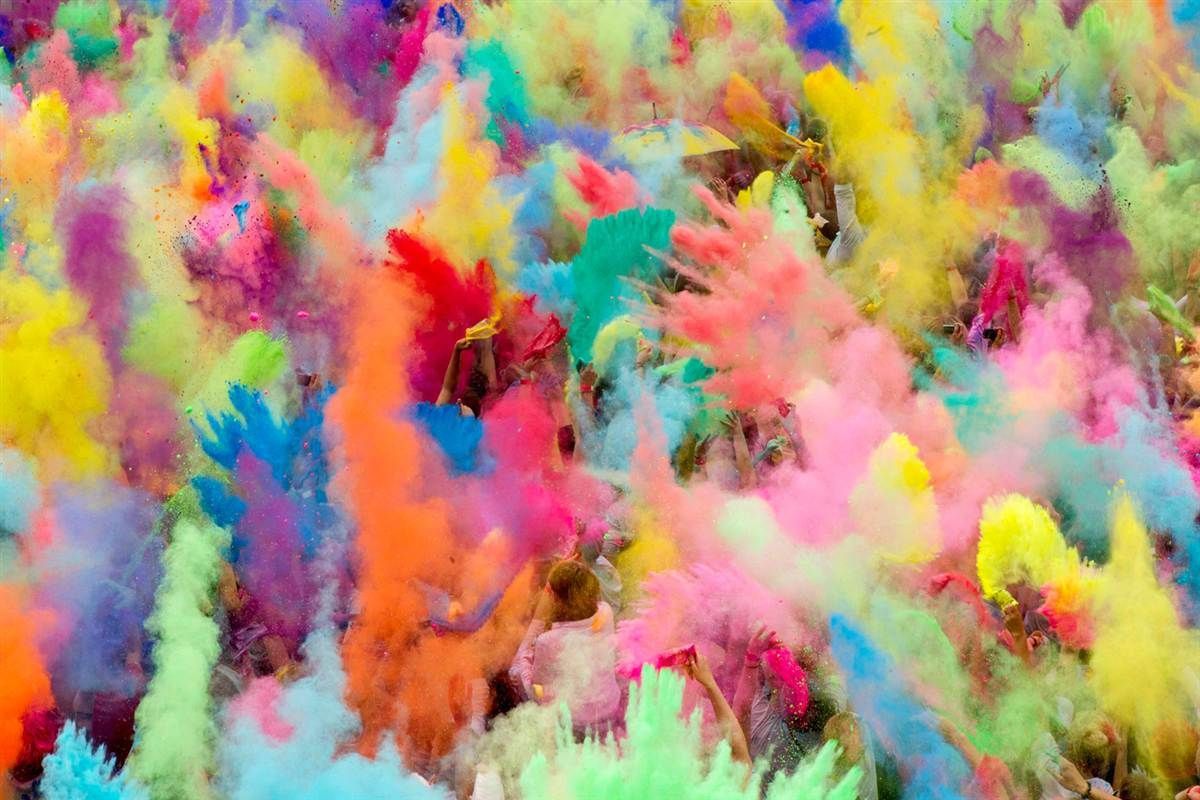 People throw colored powder in the air during a Holi celebration in Berlin. The Hindu holiday, also known as the festival of colors, heralds the arrival of spring. (Thomas Peter/Reuters)