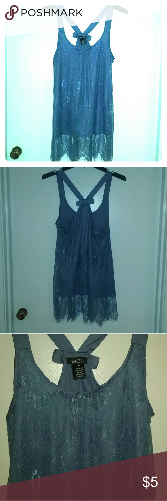 Baby blue lace tank Baby blue Rue 21 lace tank with satin straps and bow in the back. Long length, flowy fit. Size small but fits more like a medium. Can be dressed up or down. No pulls or snags in lace, has fringed bottom hem. Rue 21 Tops Tank Tops