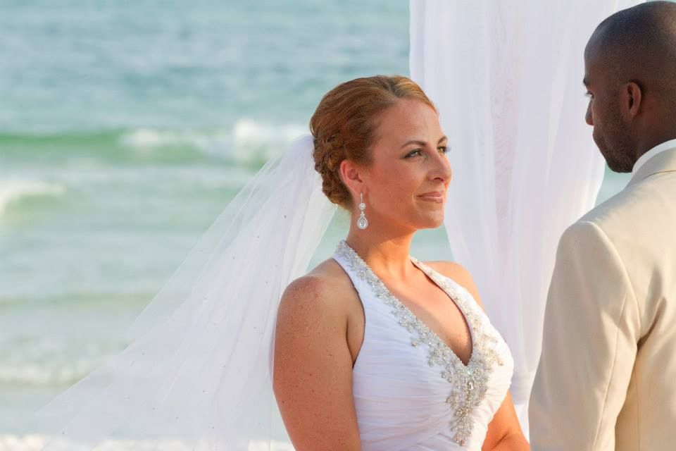 Florida beach wedding with turquoise water - groom wearing grey suit ...