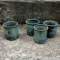 Stoneware cups in textured kiwi glaze. Food and drink safe, oven safe, hand-washing preferred. These are sold as a set of four.    Each cups varies slightly in size and finish from the rest - it's one of the perks of buying hand-made! They hold about 6 fluid ounces.