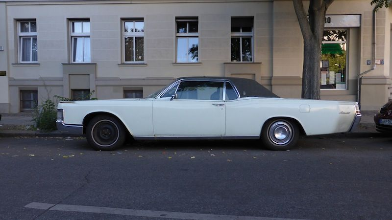 This baby was parked just outside the supermarket by my apartment in Berlin, a 1968 Lincoln Continental.  What a humongous 2-door car!