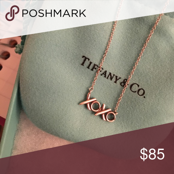 Tiffany xoxo necklace comes with bag and box. great condition. second pic is clasp with t&co serial number Tiffany & Co. Jewelry