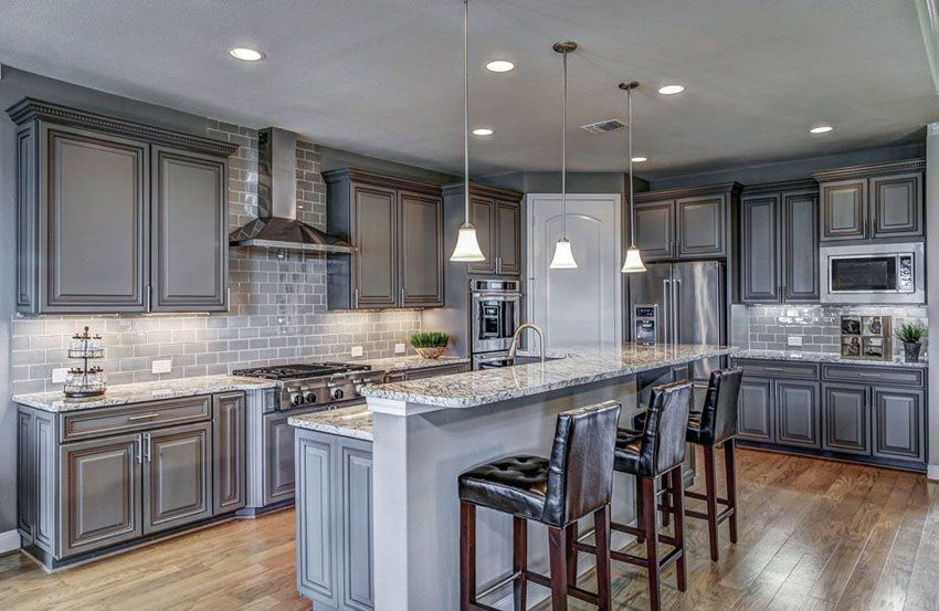 Traditional Kitchen With Gray Cabinets And Subway Tile Backsplash White Granite Countertop Breakfast Bar Island