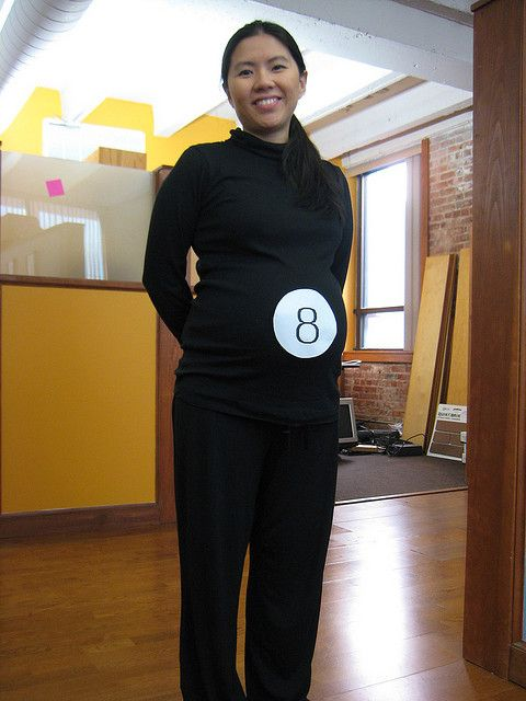 pregnant magic 8 ball costume    What you need:  Black top  Black pants  Printed the 8 on a piece of paper, cut it in a circle.   Tape it on your belly!     Voila!!    Easy and it took less than 5 minutes!