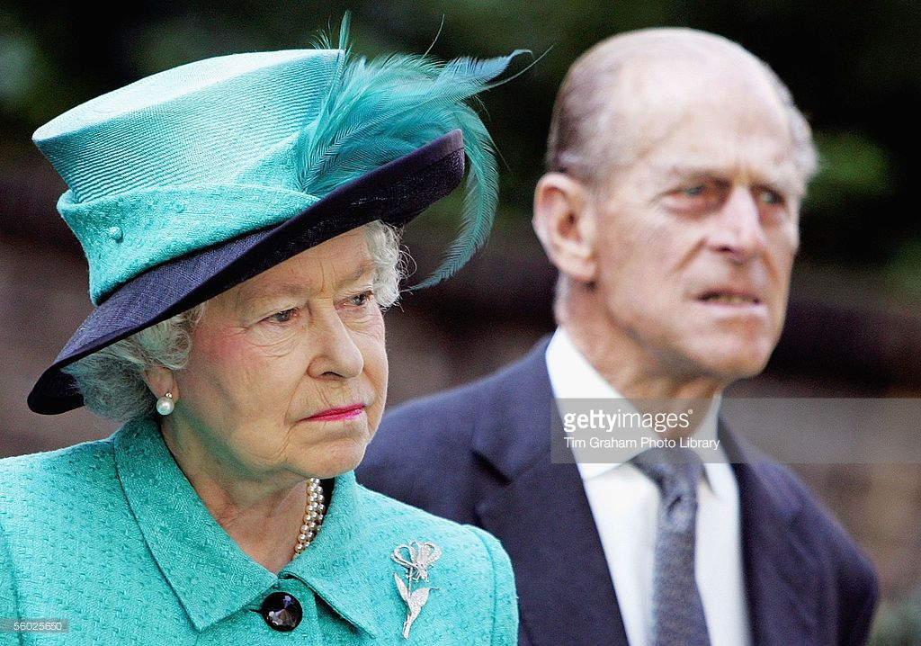Queen Elizabeth II and Prince Philip The Duke of Edinburgh look on as Norway's King Harald unveils a statue of the late Queen Maud of Norway at the Norwegian Ambassador's Residence on October 27, 2005 in London, England.
