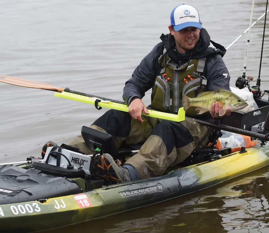 Craig Dye Holding A Largemouth Bass In A Wilderness Systems Kayak With A Motor Bass Fishing Bass Fishing Tips Largemouth Bass Fishing