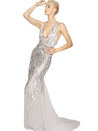 Silver Sequin Evening Dress by Roberto Cavalli. Buy for $7,085 from LUISAVIAROMA