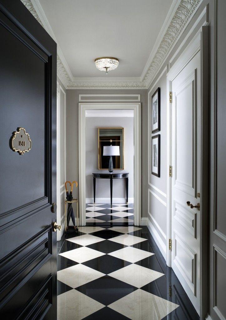 Massive-black-hallway-door-inside-a-luxurious-apartment-724x1024