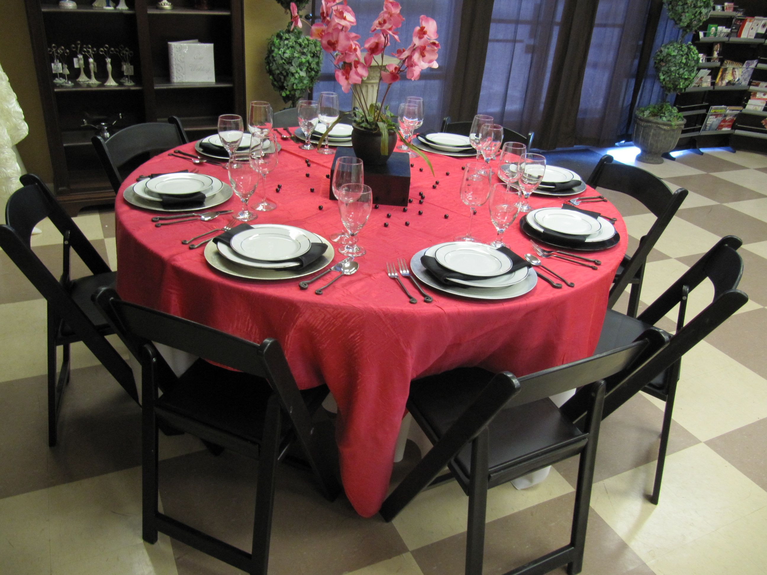 Crushed Fuschia Linen, Black Resin Chairs, Silver Chargers, Platinum Band  Plates And Frolic