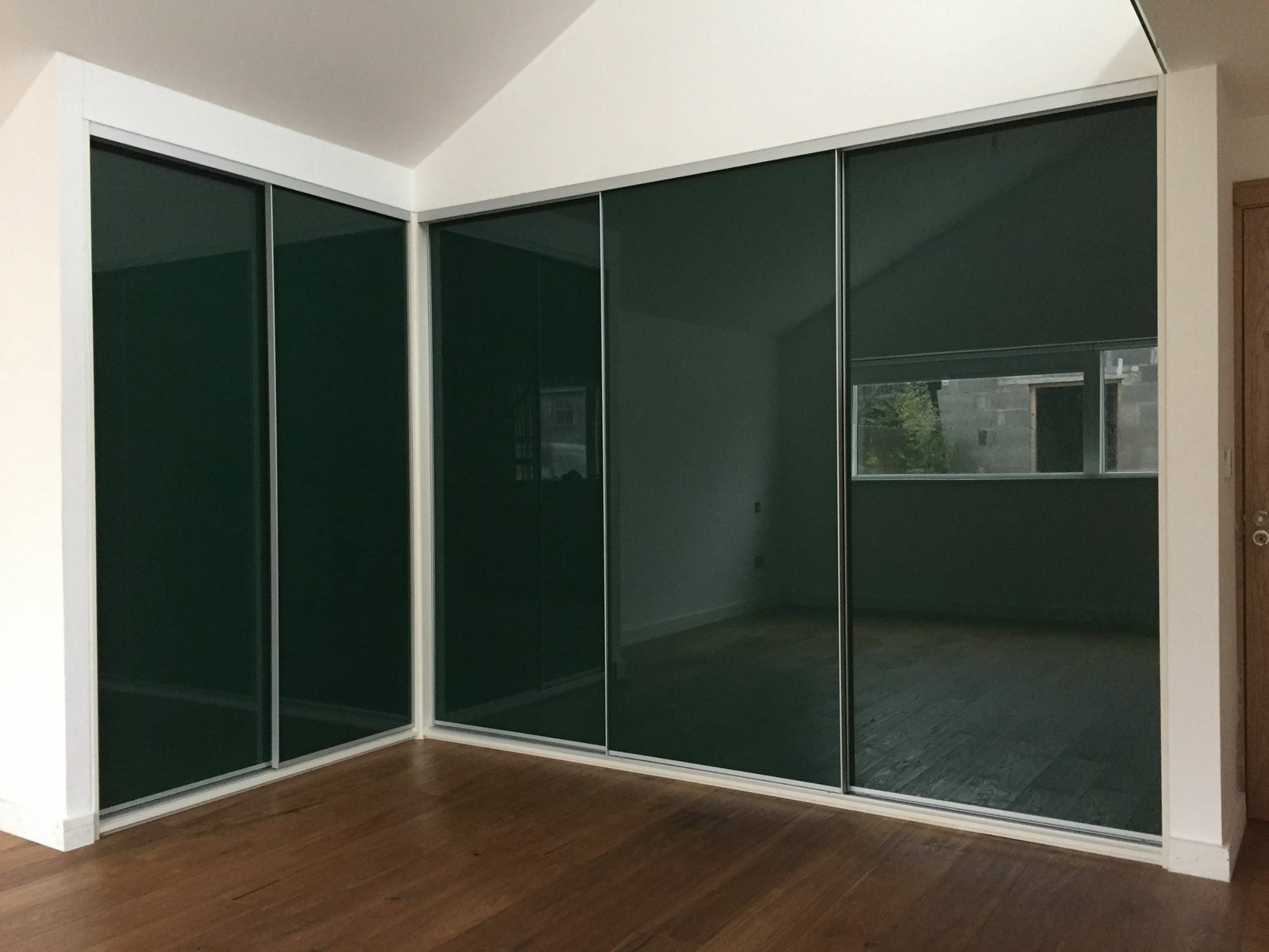 Green glass sliding wardrobe. Designed , made and fitted ...