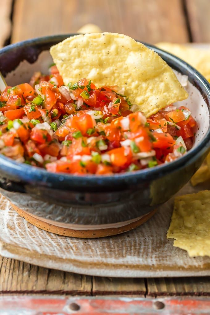 Homemade Pico de Gallo is a MUST MAKE for Summer and especially Cinco de Mayo. We love this EASY, quick, and flavorful Salsa Fresca that's loaded with fresh tomatoes, onion, garlic, lime juice, cilantro, and jalapeno peppers. This Pico de Gallo Recipe is the perfect topping for steak or chicken or is perfect for chips and salsa. Best recipe for Summer! #picodegallorecipes