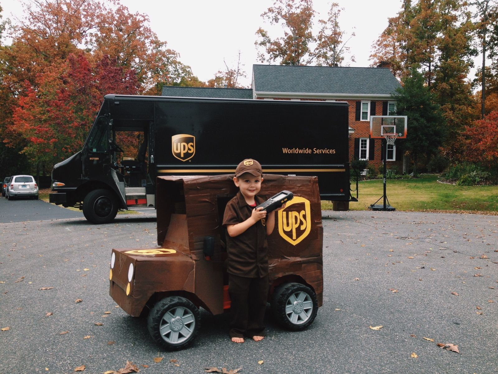 Turned his Power Wheels Jeep into a UPS truck for Halloween