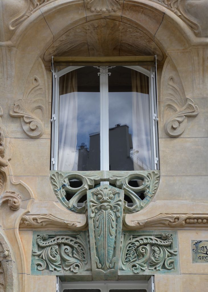 Window with plants and odd creature - Lavirotte building, Paris