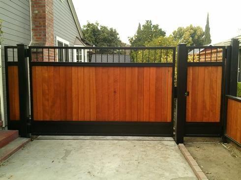 131218 Iron Wood Gates At Www Ccoigateandfence Com Driveway Gate Custom Design Automatic Gate Electric Gate W Wood Gates Driveway Wood Gate Modern Driveway