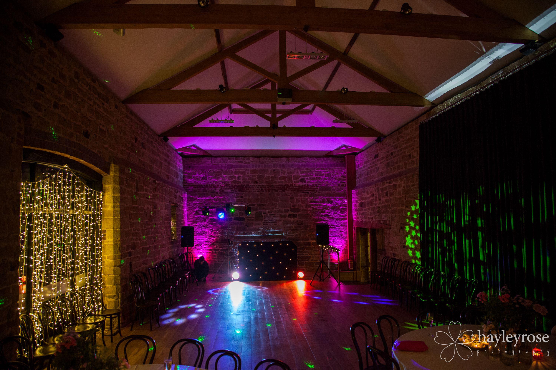 Dancefloor with disco lights at Hendall Manor Barns