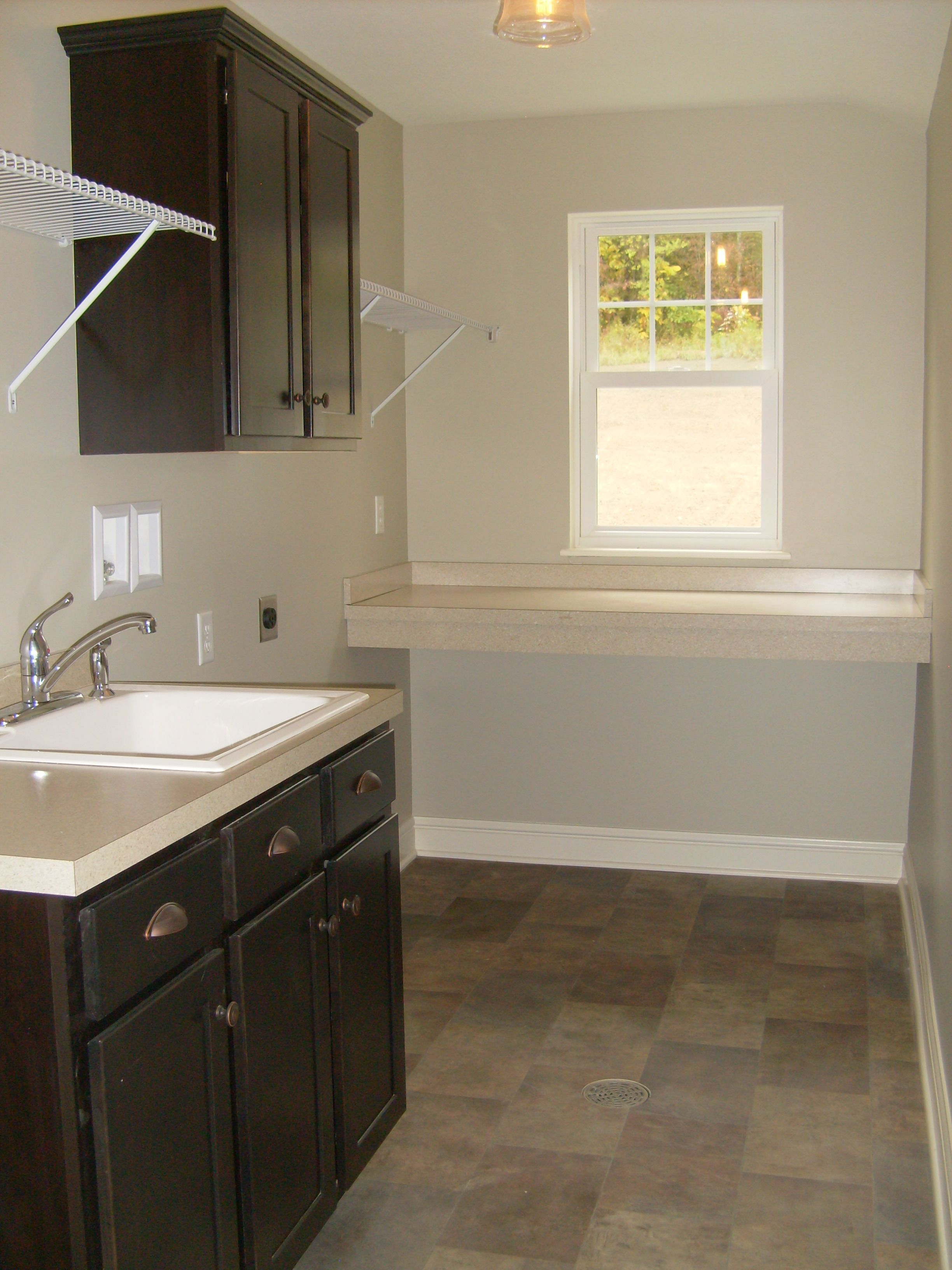 This Laundry Has Sarsaparilla Color Cabinets Laminate Counter Tops And A Drop In Laundry Sink Ref Keith Homes 304 Laundry Room Closet Laundry Sink Home
