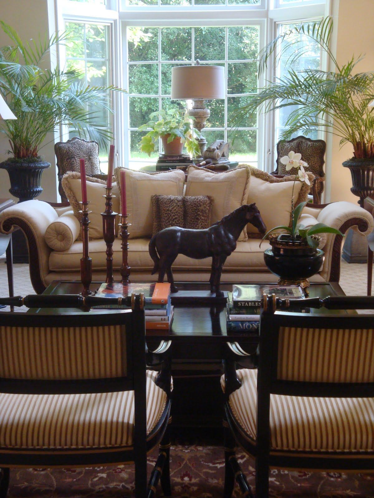 Nice looking sitting room with formal settings, antique accessories ...
