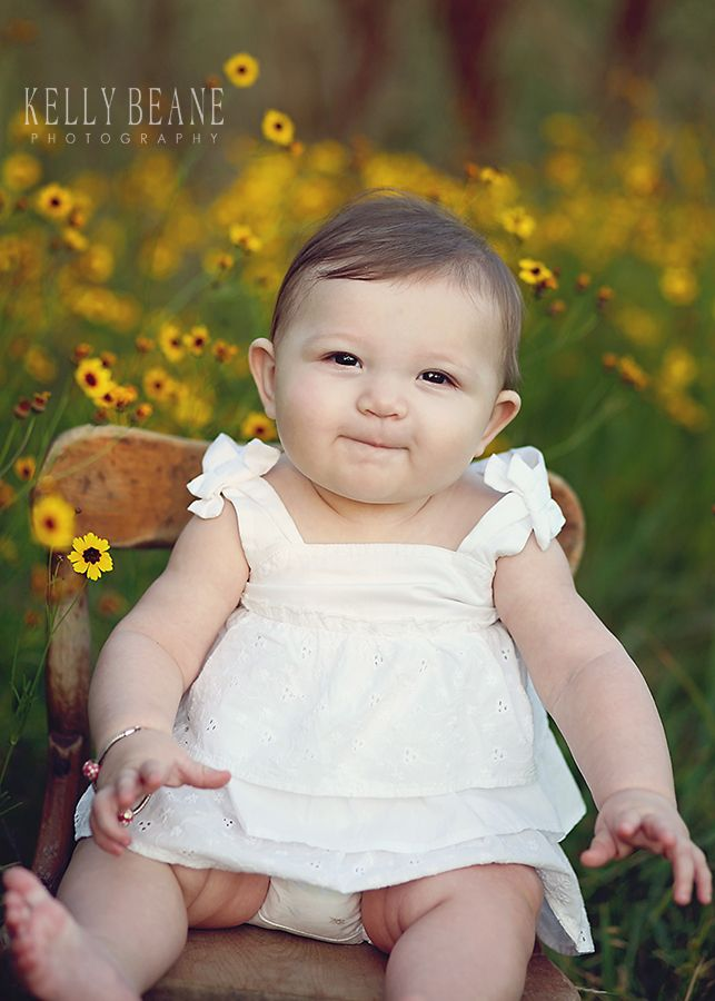 6 month baby girl.  Sunrise session, pretty flowers and precious baby.  Kelly Beane.