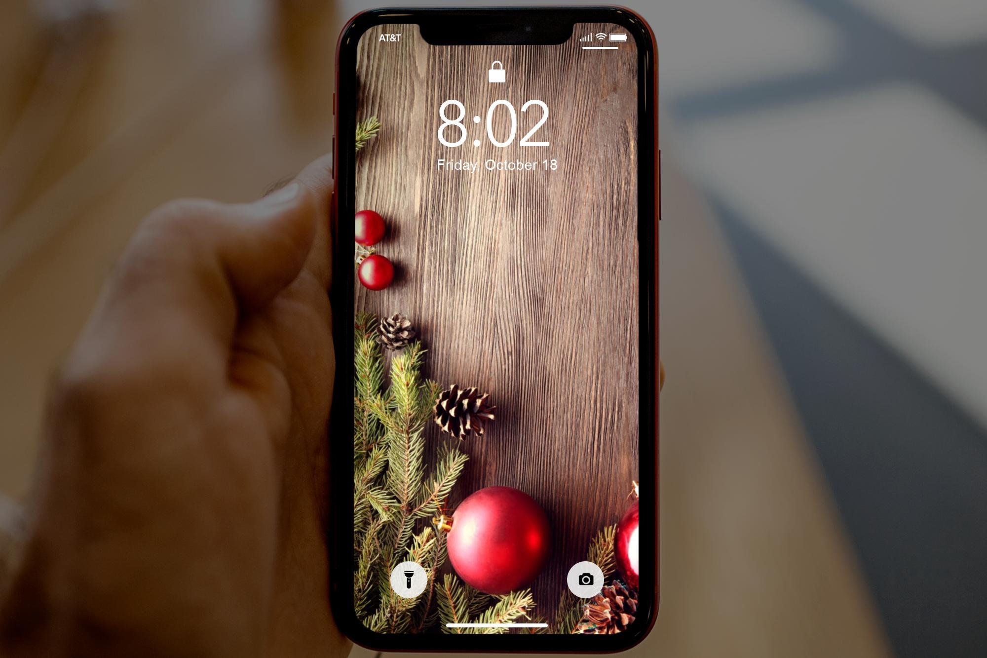 Christmas Wreath With Ornaments On Dark Wood, Christmas iPhone wallpaper, Christmas Cell phone background, Christmas iPhone lock screen #darkiphonewallpaper
