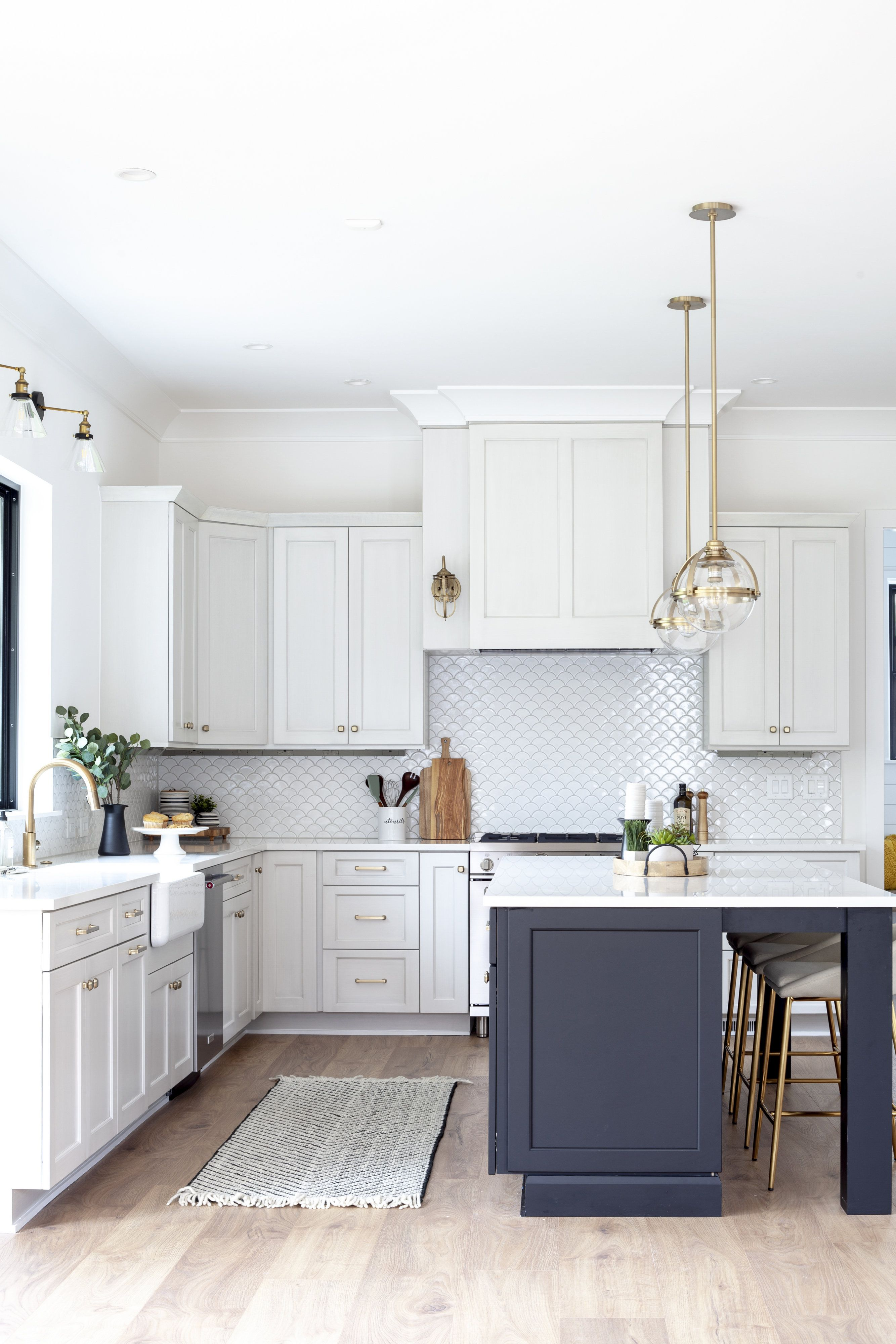 modern farmhouse kitchen with brass and