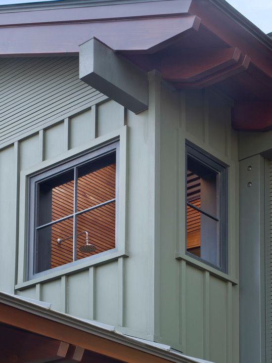 breathtaking board batten wood siding gray windows frames