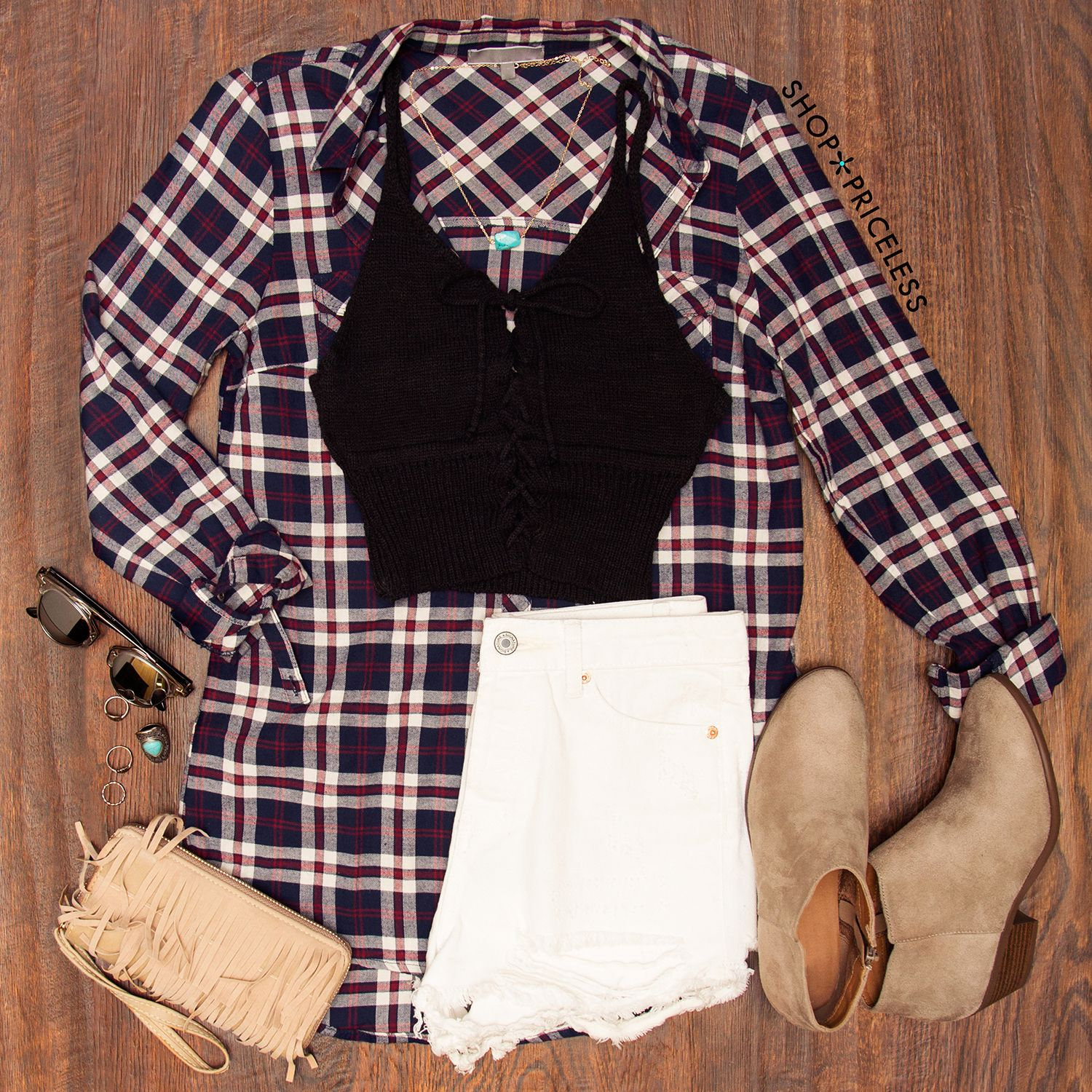 - Details - Size Guide - Model Stats - Contact Good girl gone bad! This Well Behaved Plaid Top features a soft fabric with minimal stretch in a multi-colored plaid print. Button-down front closure, a