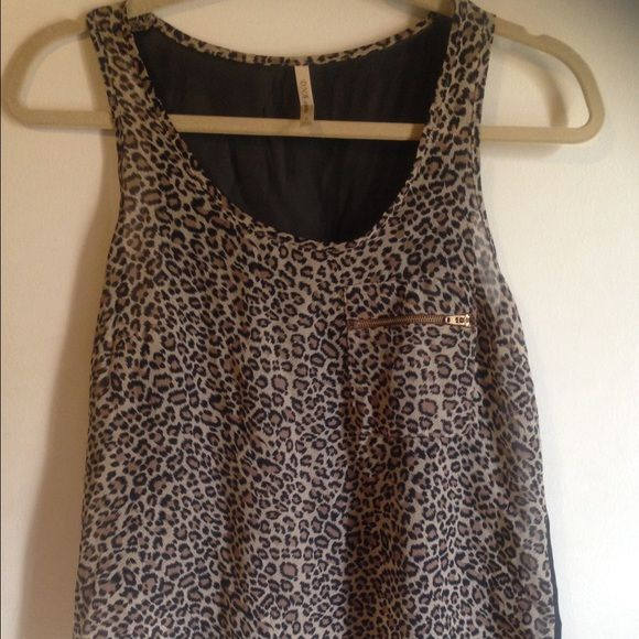 Sheer leopard tank Sheer leopard tank. Pocket has gold zipper. Back is all black and sheer Tops Tank Tops