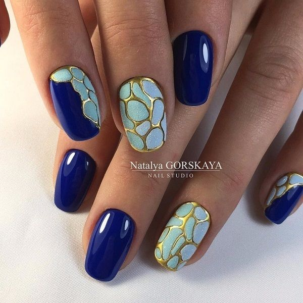 The Gold, glittery, Blue Nail Art Design. This gold framed blue nail art design is something unique yet elegant to try on. So, if you want something unique, get this on your nails.