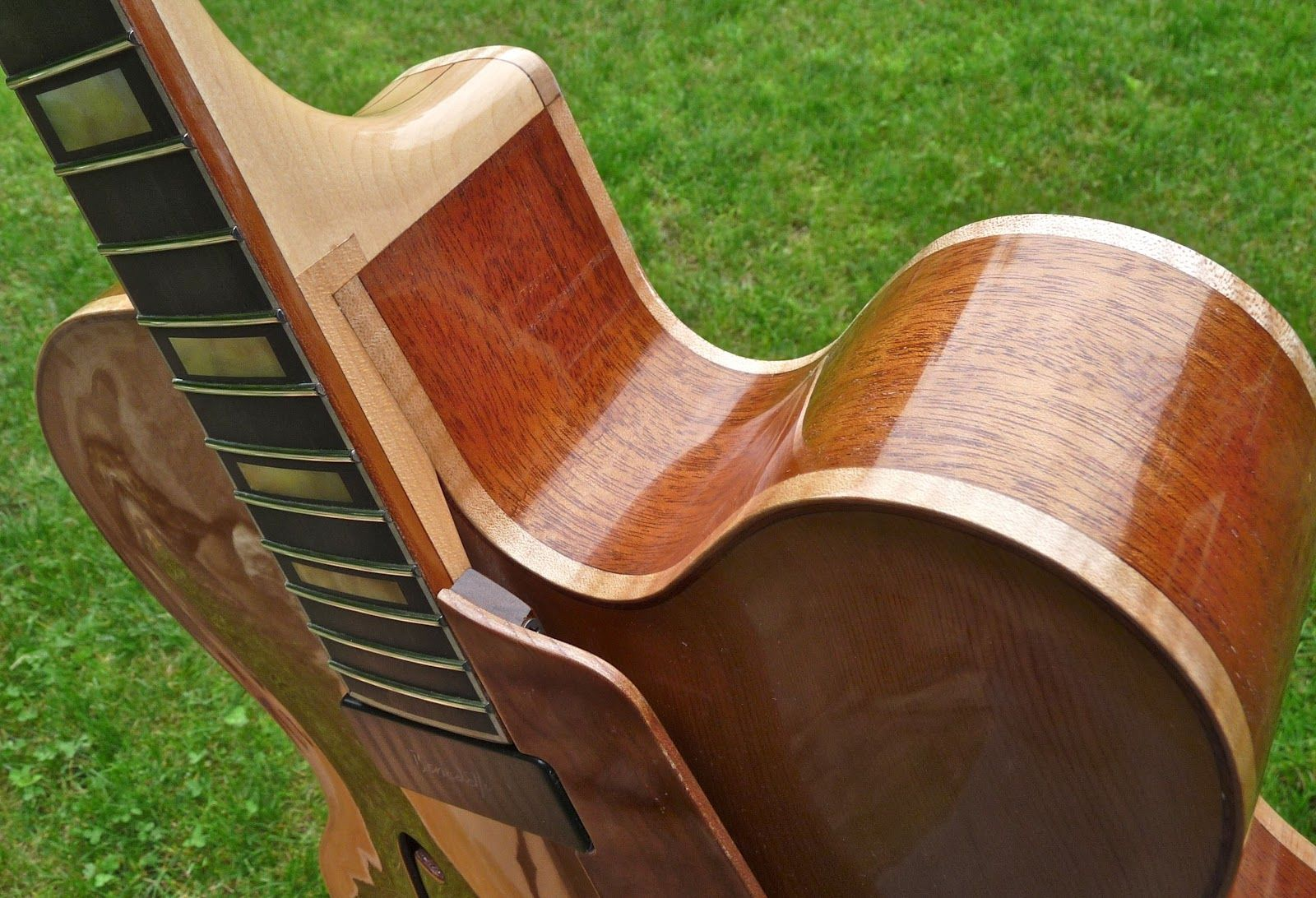 With the neck and body in one guitar-like object at last, it comes time to start finishing up - which means constructing and detailing th...