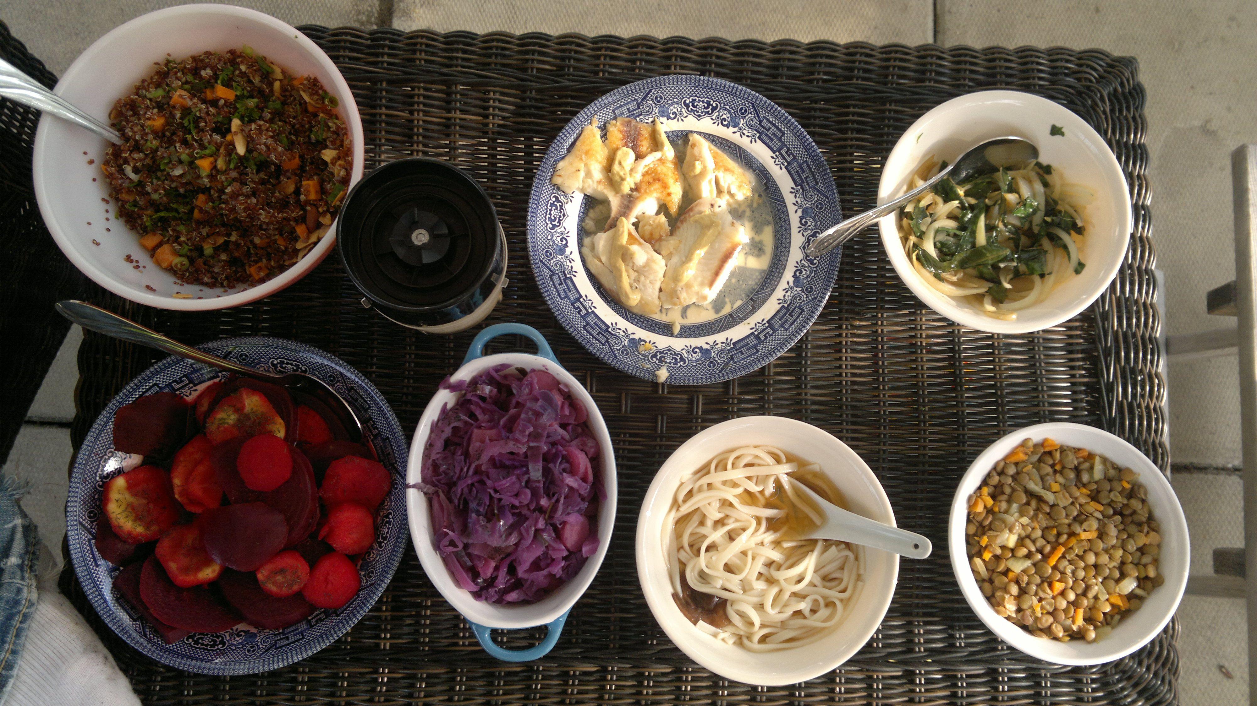 quinoa salad w/ tahini dressing, fish, sauteed onion + dandelion greens, chickpeas, udon noodles w/ broth, purple cabbage salad, and turnip + beet w/ dill