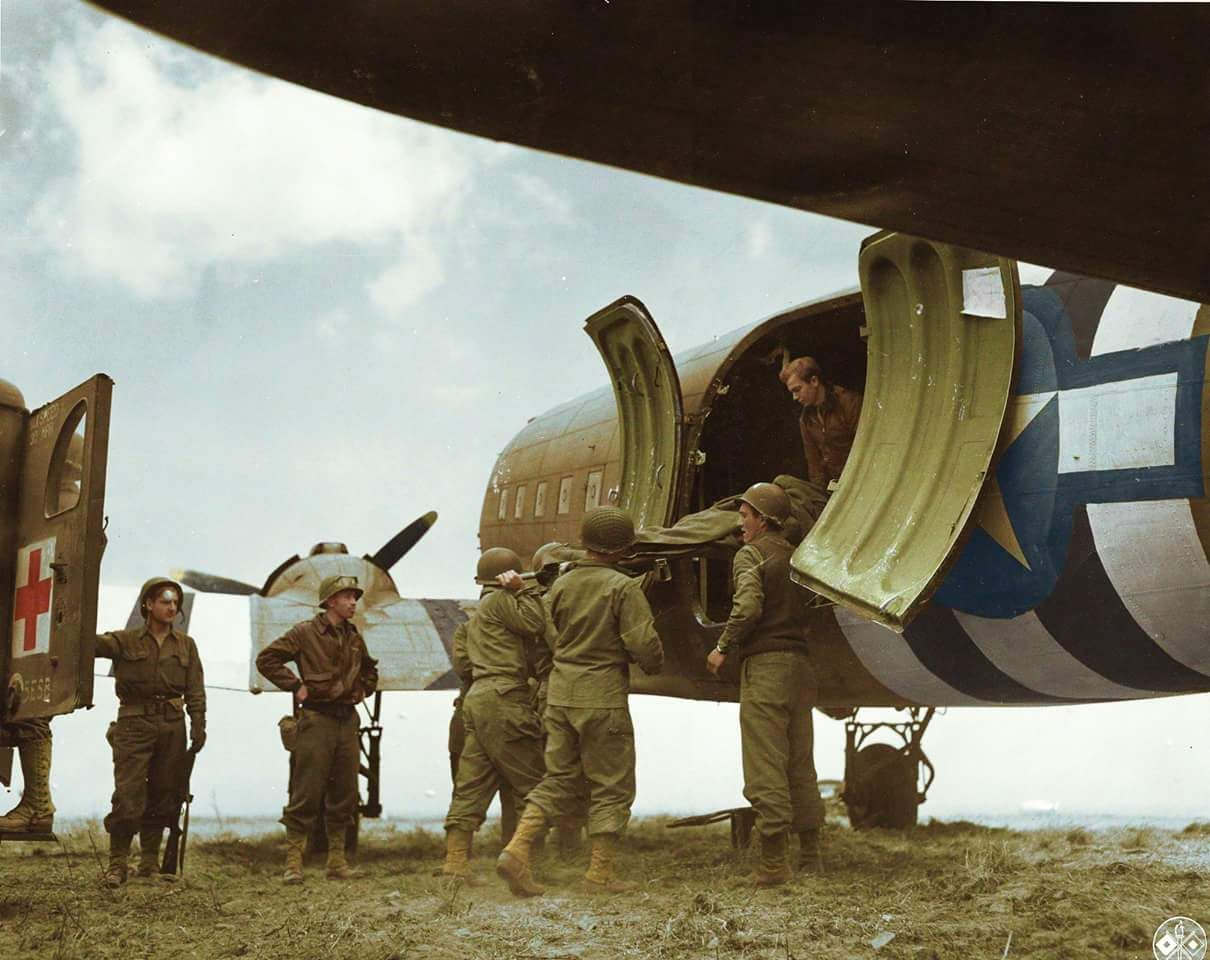 Members of a US Medical Corps lift wounded onto a Douglas