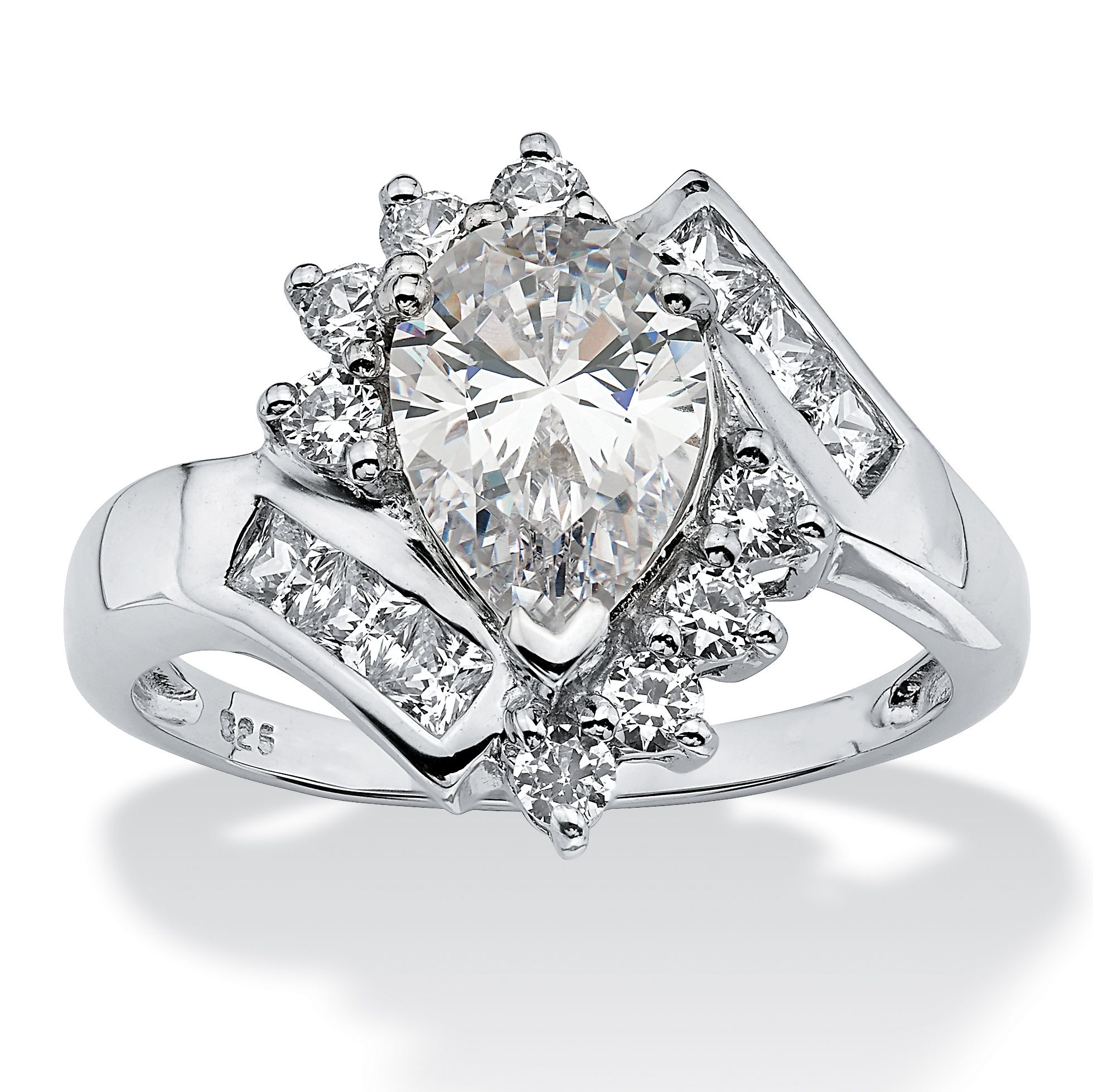 A Cascading Spray Of Cubic Zirconia Stones Creates An Extravagant Show Of Sparkle Set In P Pear Shaped Diamond Ring Engagement Ring Prices Pear Shaped Diamond