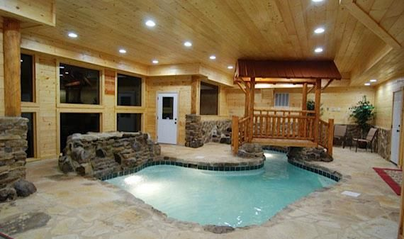 Log cabin house with a pool on the inside pools for Cabin indoor pool
