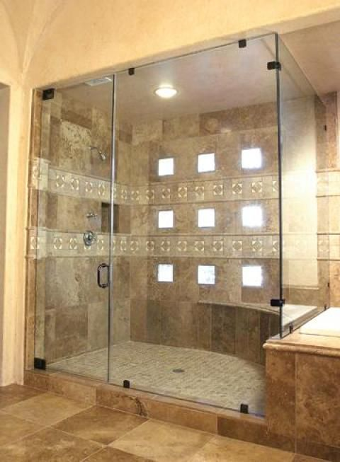 Traditional Bathroom with glass shower stall walls and door ...