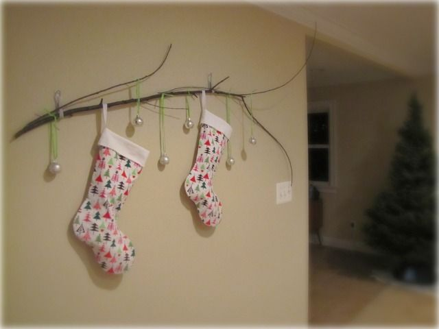 Use Command Strips to hang a branch to wall for hanging Christmas ...