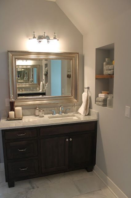 Love the vanity and mirror. Offset sink to one side ...