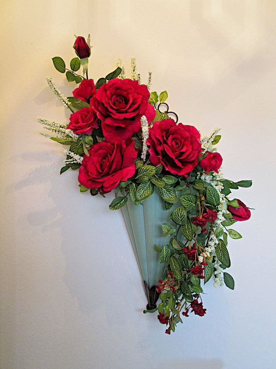 Silk Flower Arrangement With Red Roses In A Wall Pocket
