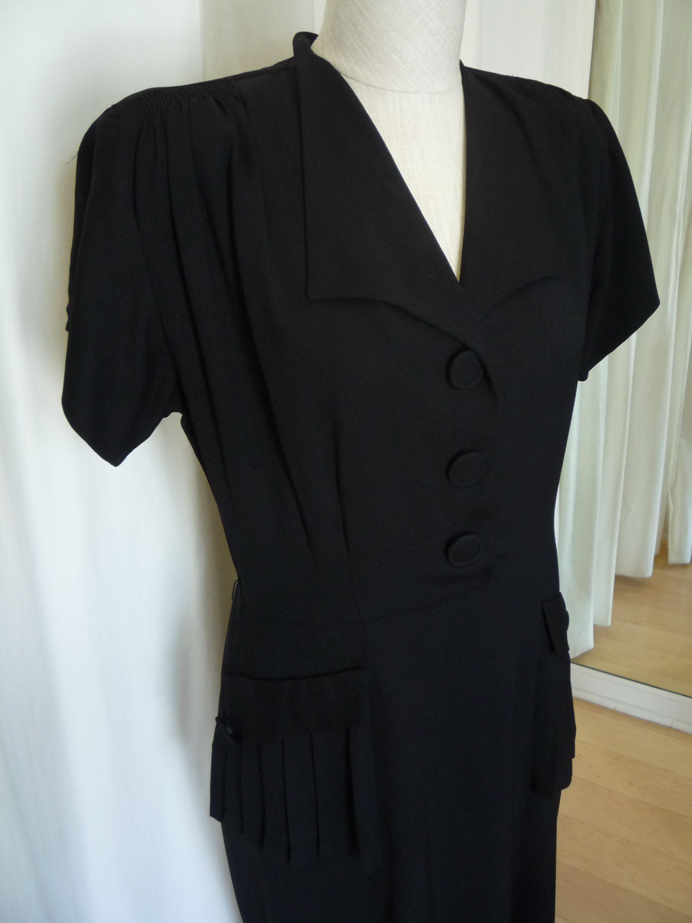 1940's style! https://www.etsy.com/ca/listing/192698762/vintage-black-crepe-short-sleeved-dress?ref=listing-shop-header-2