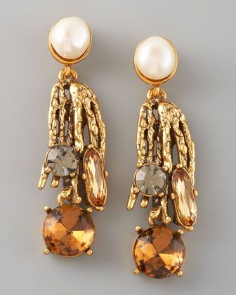 Nothing gives your look more panache than statement jewelry—these conversation-starting Oscar de la Renta earrings features a coral motif and a spray of crystals so refreshing, we can feel the ocean breeze. 24-karat yellow gold-plated pewter and brass.