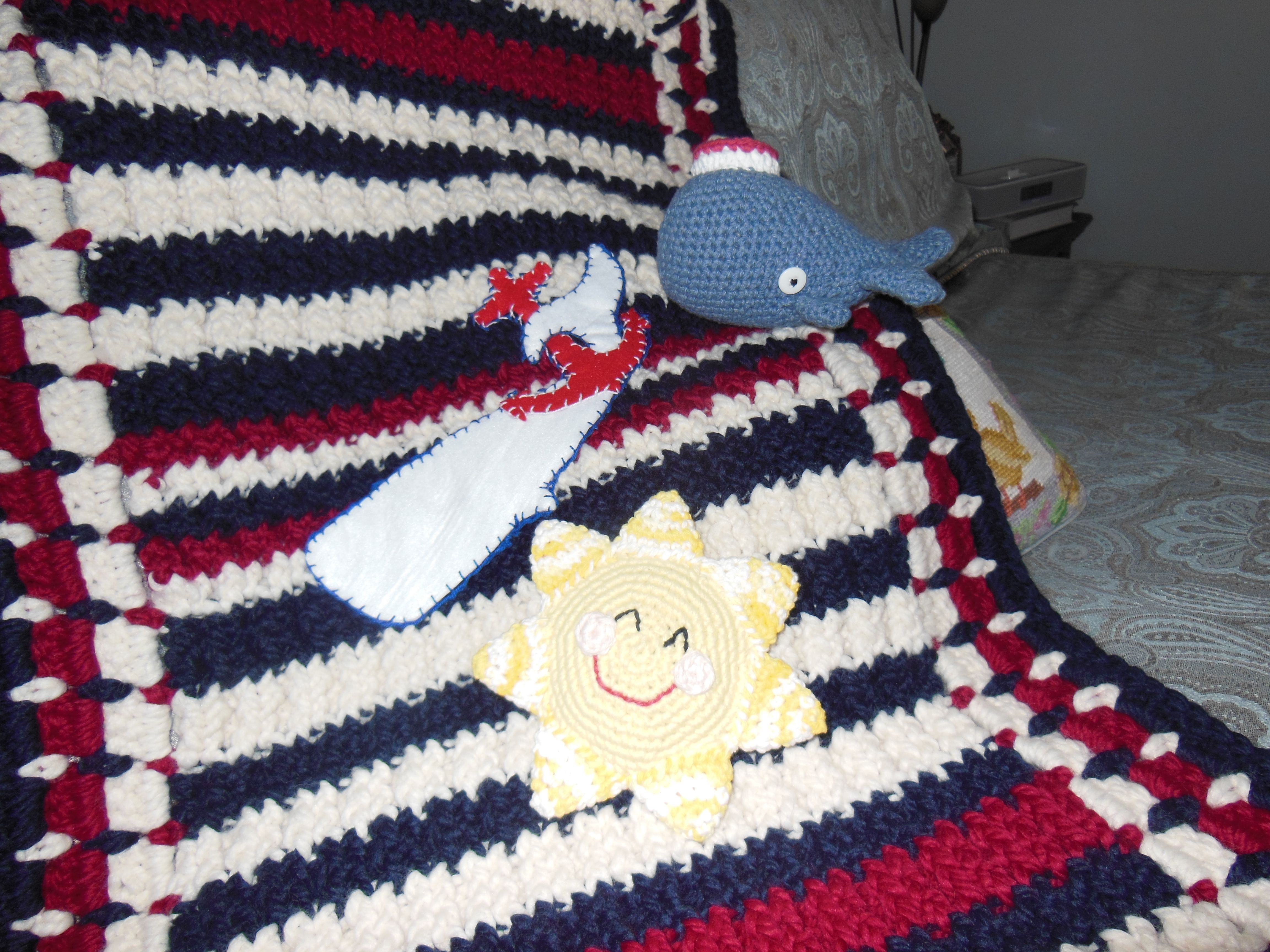 crocheted sunshine rattle, knitted and crocheted blanket and crocheted amigurumi whale