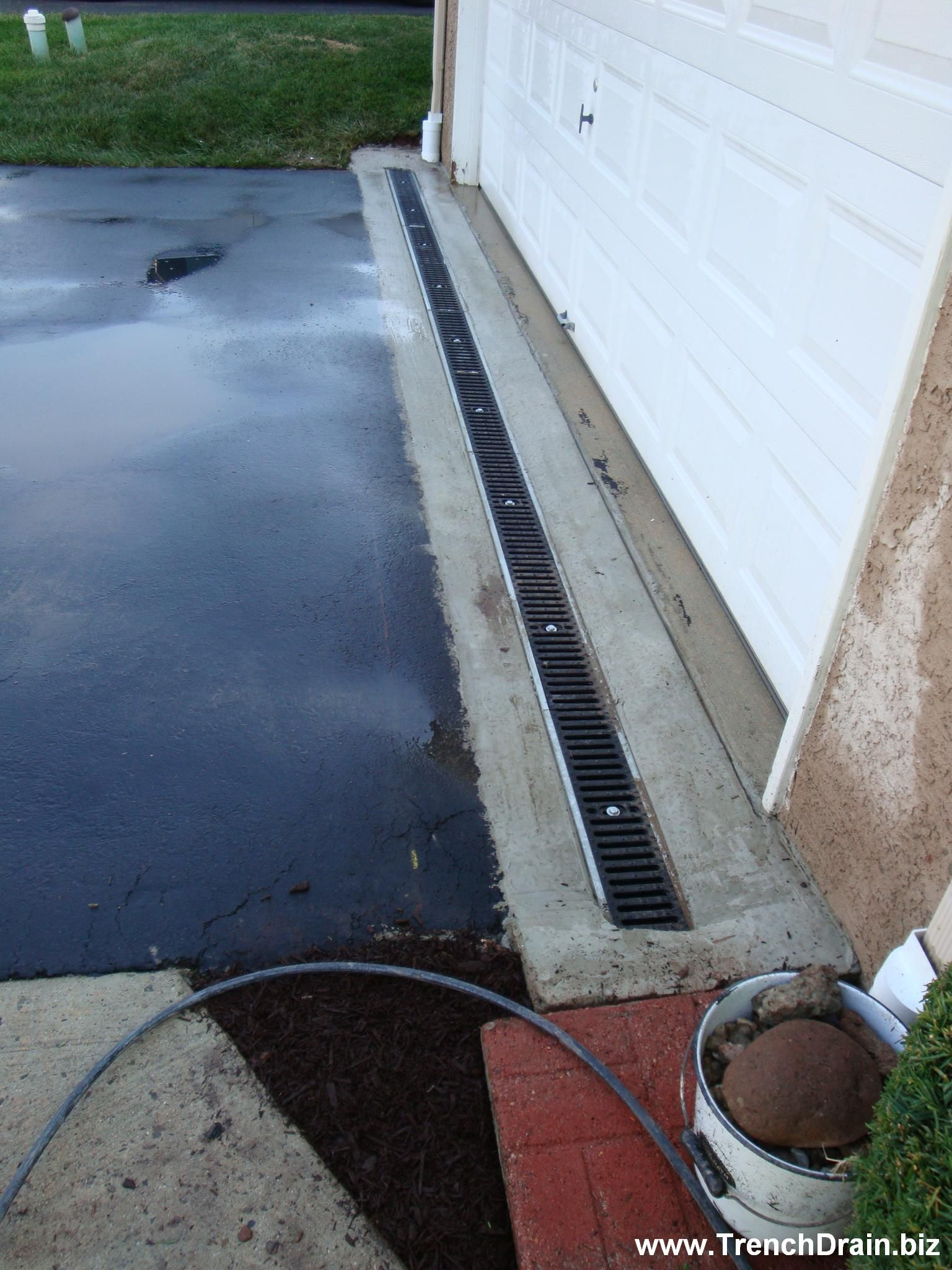 Trench Drain Installation For The Residential Driveway Trenchdrainblog Com Backyard Drainage Drainage Solutions Yard Drainage