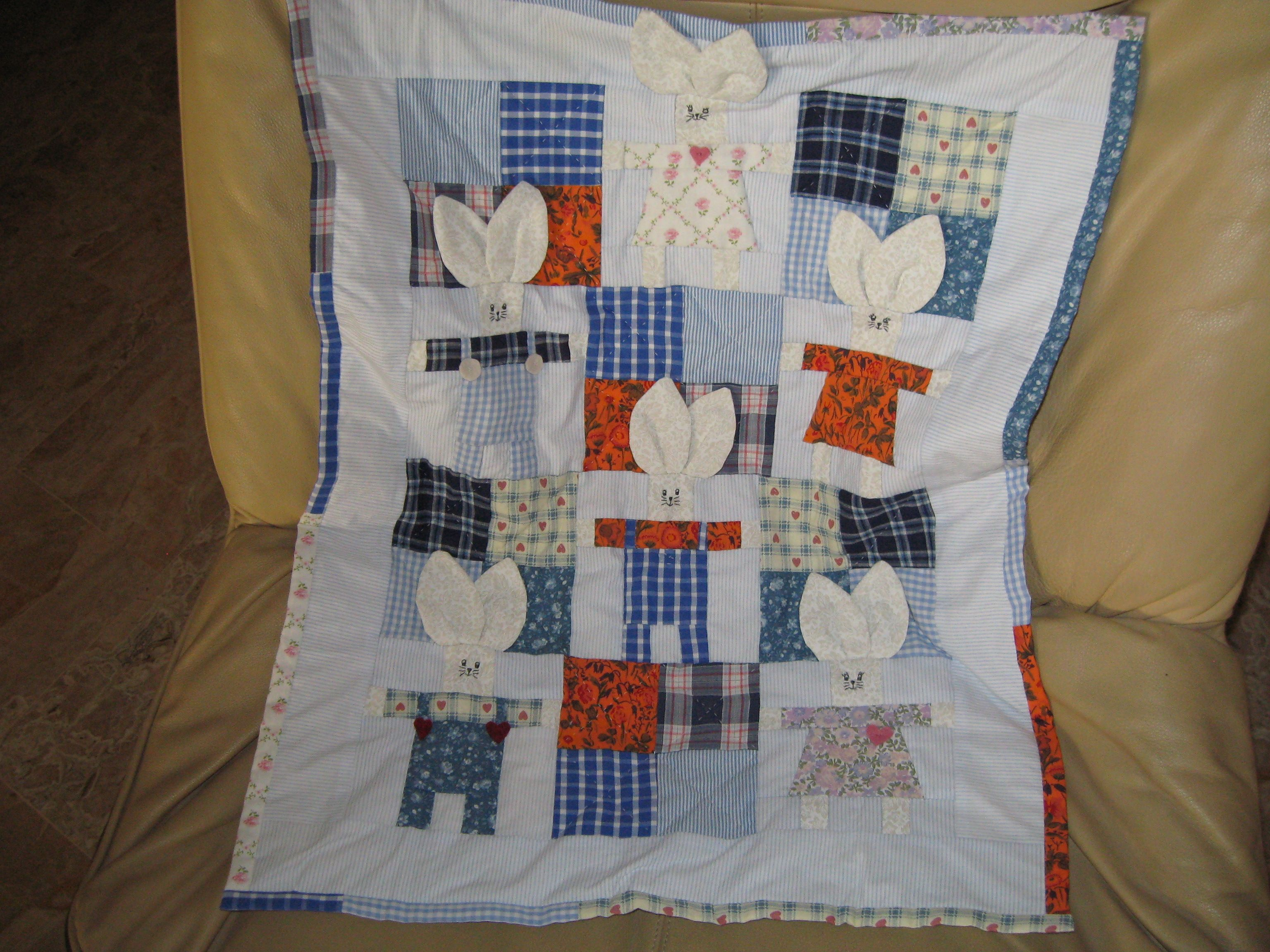 baby quilt for my granddaughter done with vintage fabric