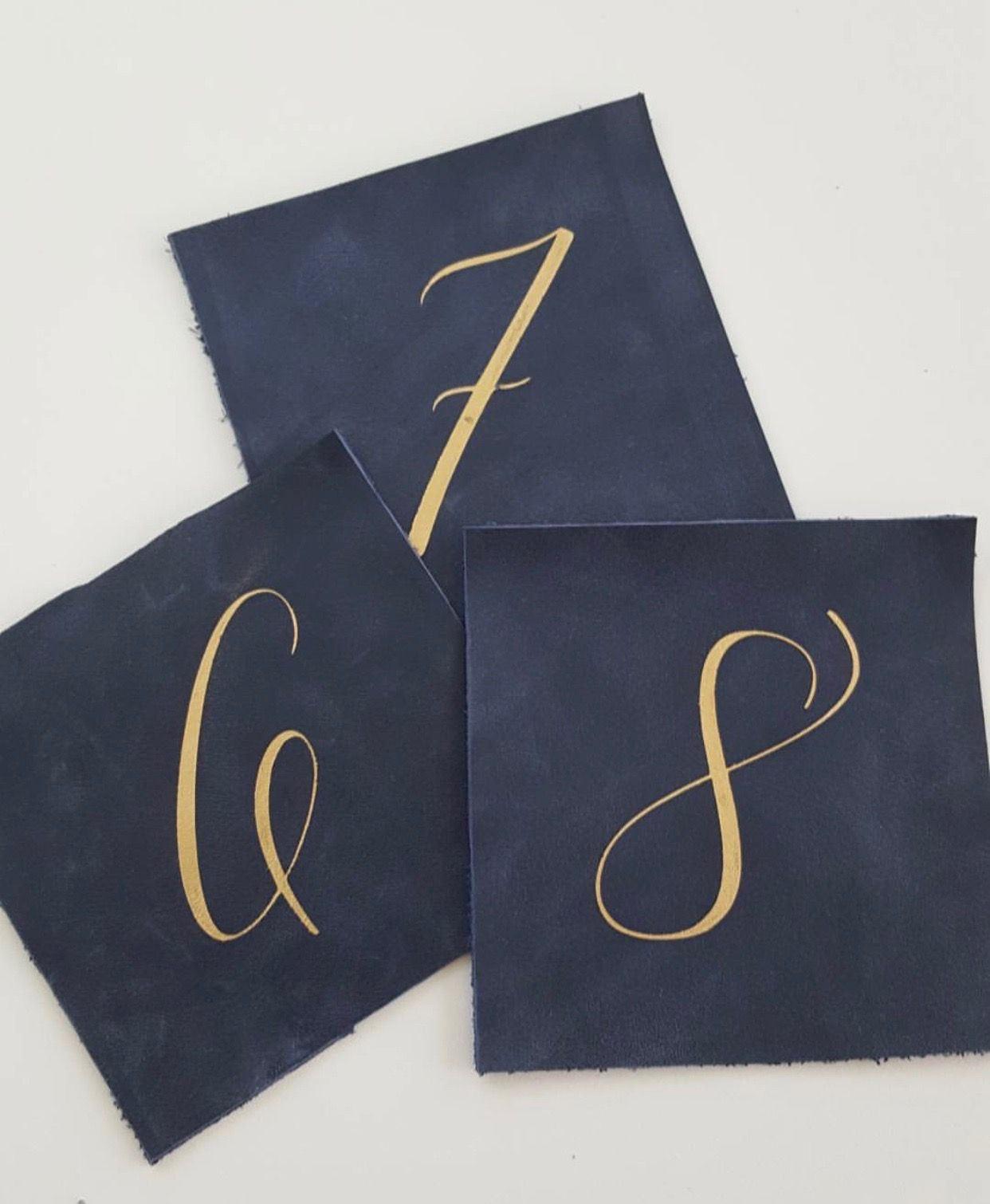 Yonder Design. Leather Table Numbers