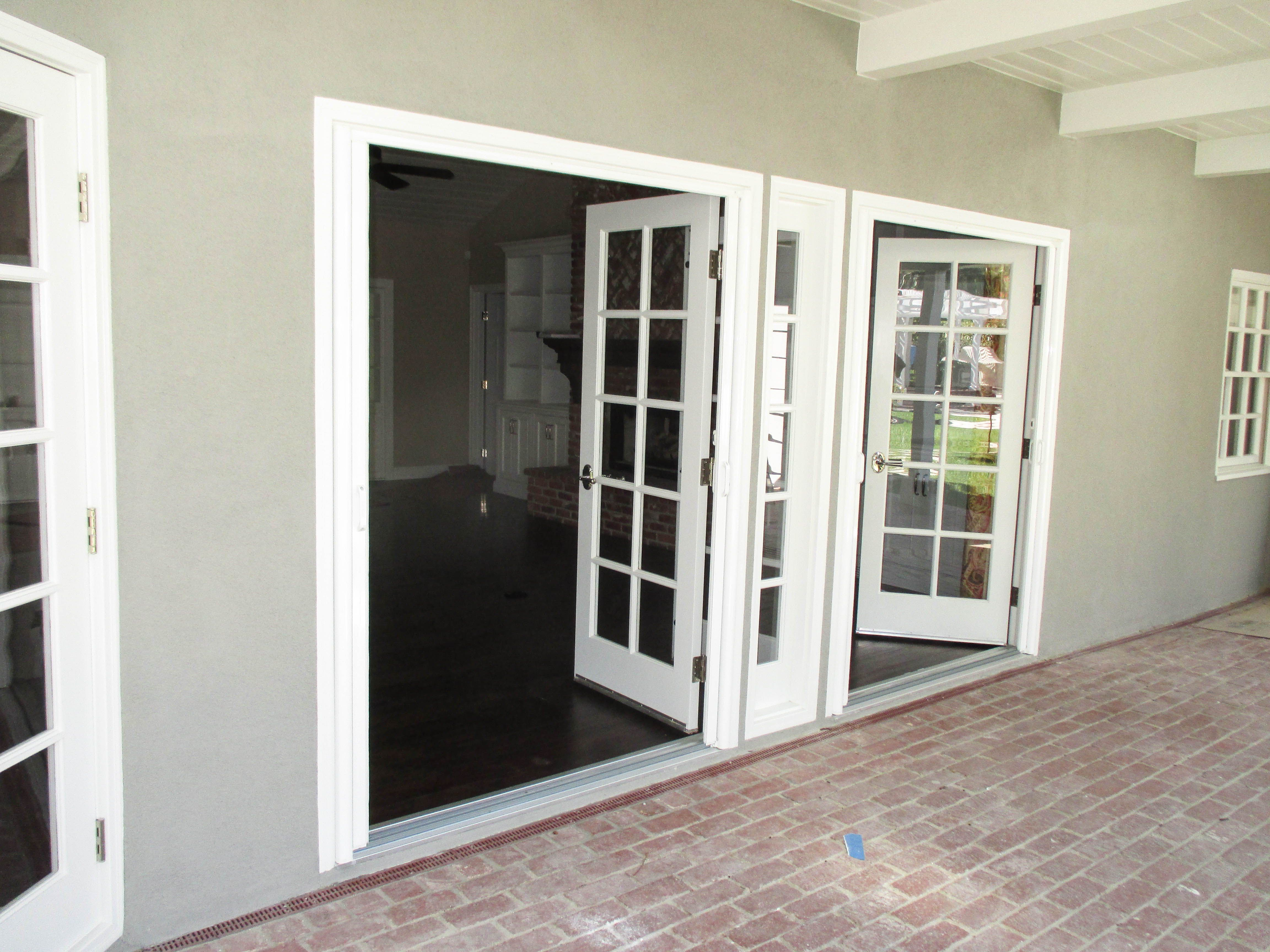 Check Out This Pair Of Double Door Inswing Bright White Stowaway Retractable Screen Doors That Our Team Install Screen Door French Doors Front Door With Screen