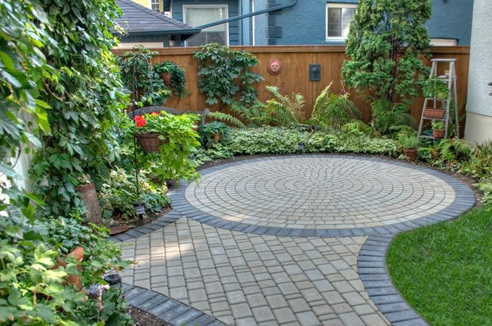 creative use of lime stone edging. View Winnipeg paving stone patios ... - Victorian Natural Paving Stone Circle With Charcoal Border