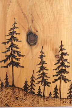 This beautiful scene has been burnt into a unique piece of cedar wood that has been stained a warm golden shade to enhance the wonderful grain of the woood. The pine trees have been burnt into the wood by hand making this a one of a kind piece. A wonderful warm addition to your home!  Measures almost 7 inches high by 5 1/2 inches across by 3/4 inches deep.  Carefully wrapped and ready to ship.