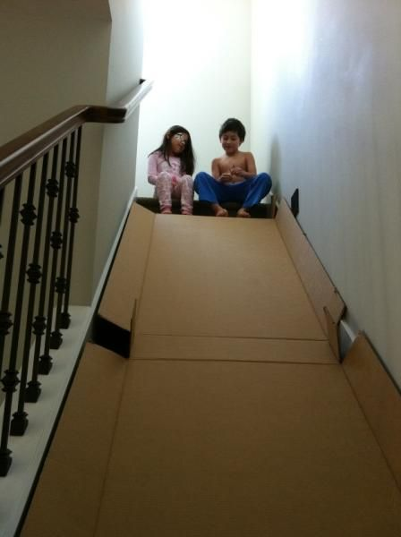Turn A Staircase Into A Slide By Flattening Cardboard Boxes.