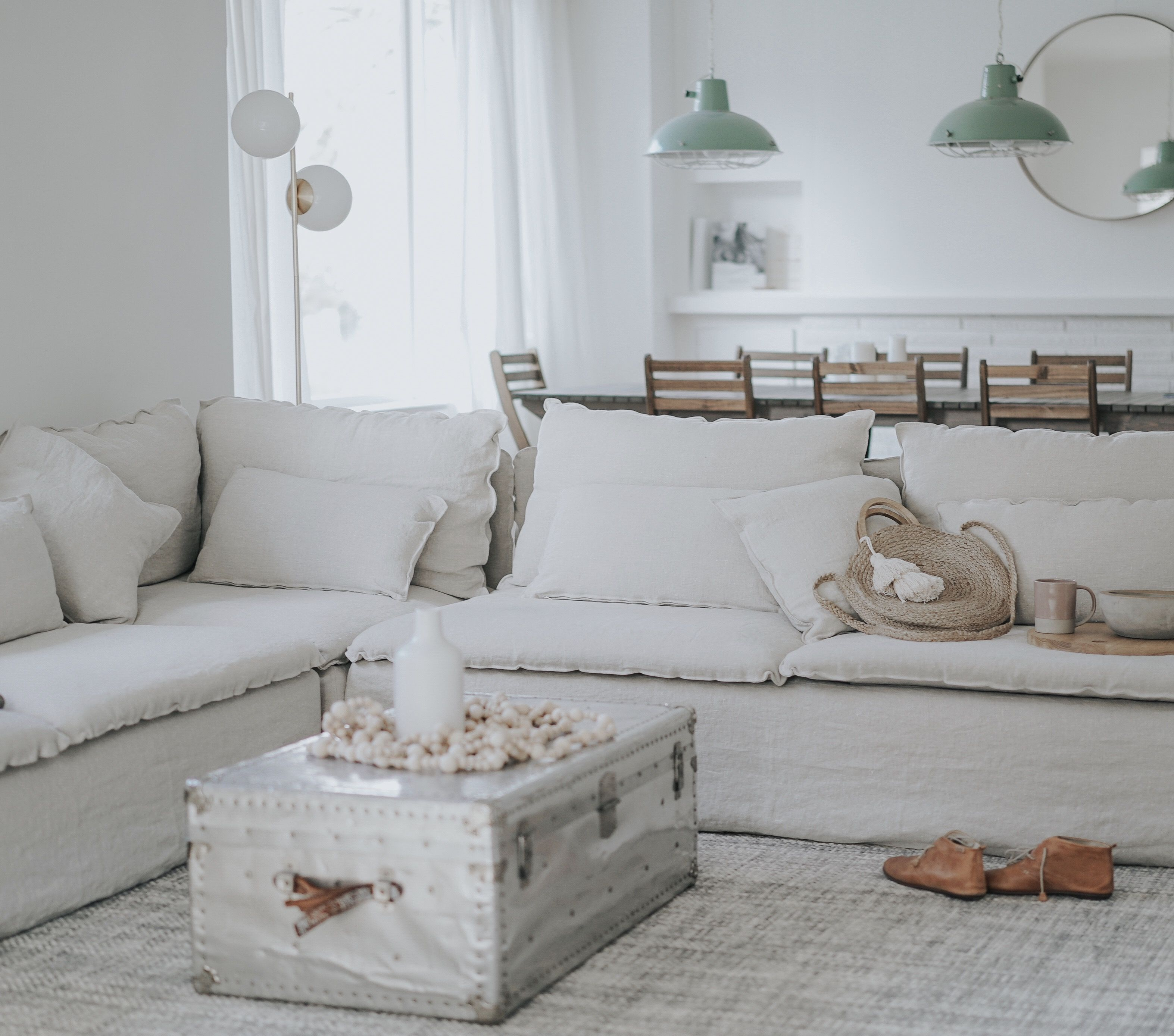 This Summery Space Makes Want The Sunshine Whites And Muted Shades Of Blue Pink White Linen Sofa Living Ro White Linen Sofa Living Room Sofa Ikea Sofa